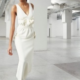 White evening dress with drapery
