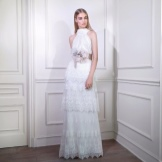 White evening dress with a multi-tiered skirt