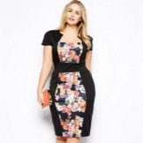 Sheath dress combined from black and colored fabric for full
