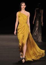 Yellow evening dress on one shoulder