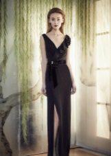 Black evening dress with a slit by Jenny Packham