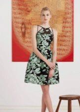 Black evening dress with a green print