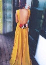 Mustard dress with open back and roses