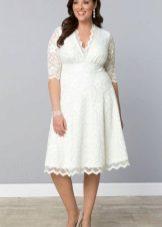 Witte jurk voor dikke buik