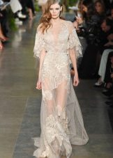 Long transparent dress on the floor with a printed lace of milky color