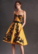 Yellow dress with black print