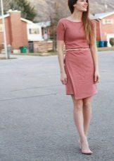 Sheath dress with an asymmetrical bottom skirt