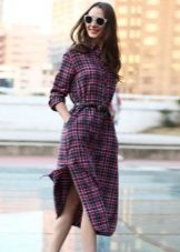 Checkered shirt dress with a belt below the knee and with slits on the sides
