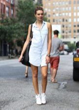 Denim shirt dress with sneakers and bulk bag