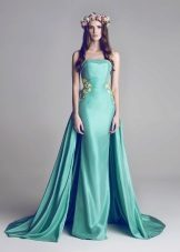 Turquoise dress with a train and open shoulders