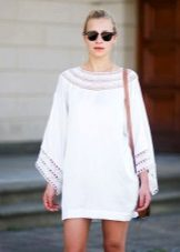 Knitted white tunic dress with sleeves