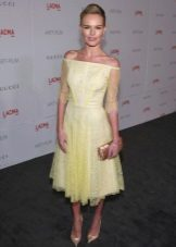 Yellow lace dress with mid-length skirt