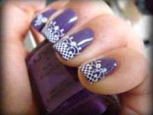 Purple manicure with white lace