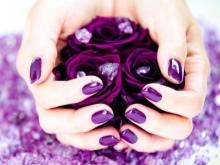 Purple manicure under a purple dress