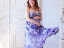 Lila kleedje voor zwangere fotoshoots