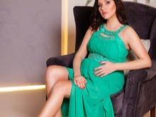 Smaragdachtige jurk voor zwangere fotoshoot