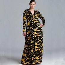 Vestit llarg groc i negre amb escot profund i màniga llarga per complet