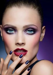 Makeup with purple shadows and red lipstick