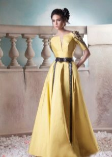 Yellow evening dress with black leather inserts