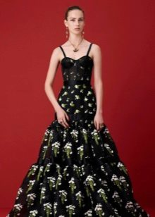 Black evening dress with a green pattern