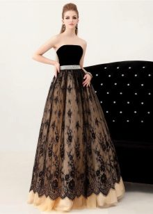 Black lace evening dress in combination with a contrasting backing