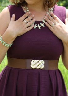 Eggplant dress with mint-colored accessories