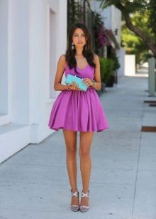 Fuchsia dress with turquoise clutch