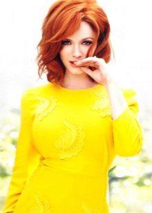 Redhead girl in mustard dress