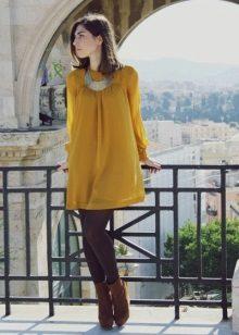 Brunette in mustard dress