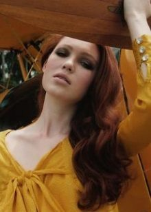 Red-haired girl in a mustard dress