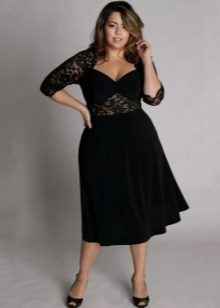 Zwarte jurk voor de volledige combo van twee stoffen: strakke jersey en kant