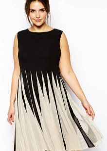 Dress with a pleated skirt medium length concealing protruding belly