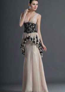 Lange jurk met elementen die de buik verbergen