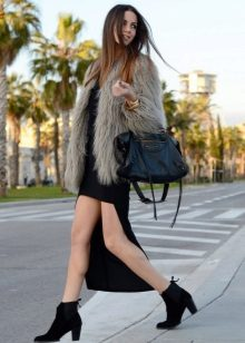 Asymmetrical dress in combination with a fur jacket