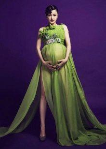 Lange groene jurk voor zwangere vrouwen