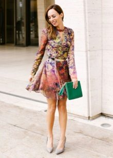 A-line colored dress with green clutch