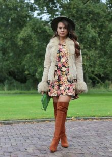 Fur jacket and brown boots for A-line dress