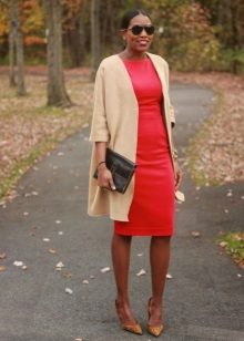 Sheath dress in combination with an elongated cardigan