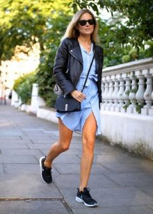 Shirt dress in combination with a leather jacket and a small bag
