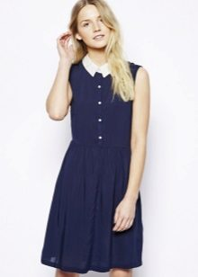 A fitted short blue shirt dress with a white collar