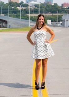 White pea dress in black polka dot with a high waist