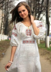 Modern Russian dress in ethnic style and ornaments for it