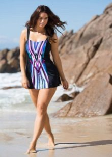 Short bathing dress with dark side panels for full