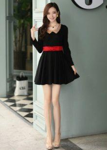Black short dress with a skirt and a sun red belt