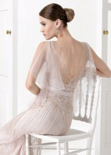 Dress with open back with a transparent sleeve