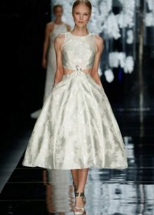 Fashionable dress in 2016 with a fluffy skirt of medium length