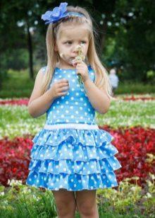 Vestido elegante para a menina curta em ervilhas