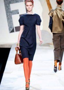 Orange tights to a blue dress