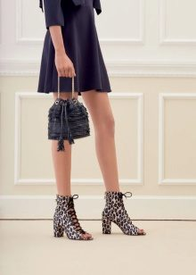 shoes with a print to the blue dress