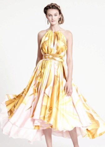 Yellow evening dress with a print